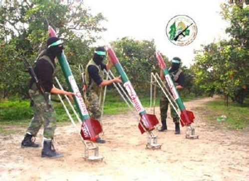 Hamas militants preparing to launch deceptively festive looking Qassam rockets