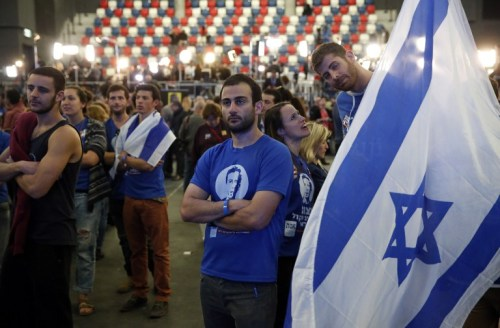 Zionist Union supporters react to exit poll figures outside party HQ  Tel Aviv, March 17th (photo credit: AFP/Thomas Coex)